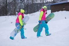 SOCHI, RUSSIA - FEBRUARY 26, 2014: Two girls go Stock Photo
