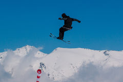 2017 04 Sochi, Russia, Festival NewStarCamp: skier jumps from a high springboard Royalty Free Stock Image