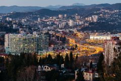 Sochi, russia - January, 2017 - View from above on the evening city of Sochi with lights, houses and highway Royalty Free Stock Image
