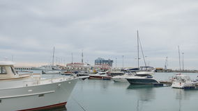 Sochi, Russia - January 18: Yachts and boats in port or harbor. View from pier stock video footage