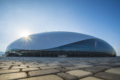 Sochi, Russia - July 16: Bolshoy Ice Dome with solar flare background on July 16, 2016. Sochi, Russia - July 6: Bolshoy Ice Dome with solar flare in Olympic Park stock images