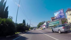 Sochi, Russia - June 2018: Driving on the highway South of the city on a Sunny day. Scene. Southern city in summer.  stock video footage