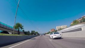 Sochi, Russia - June 2018: Driving on the highway South of the city on a Sunny day. Scene. Southern city in summer.  stock video