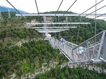 Sochi, Russia - June 10, 2016: elderly women are not afraid to take extreme and walk under the suspension bridge stock photos