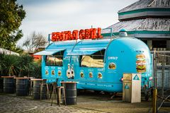 Food truck on wheels on street. Sochi, Russia - March 12, 2018: Food truck with burgers on wheels on street stock photos