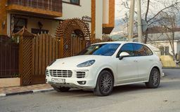 New luxury Porshe Cayenne parked on the streets of Sochi. Sochi, Russia - November 08, 2017: New luxury Porshe Cayenne parked on the streets of Sochi Stock Photography