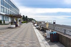 Uncrowded seaside promenade in the resort town in autumn. Sochi, Russia-October 11, 2016: Uncrowded seaside promenade in the resort town in autumn Stock Image