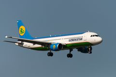 Airbus A320 jet aircraft. SOCHI, RUSSIA - SEPTEMBER 08: Aircraft operated by Uzbekistan Airways, landing in airport Sochi on September 08, 2012.The company in Royalty Free Stock Photography