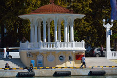 SOCHI/RUSSIAN FEDERATION - SEPTEMBER 29 2014: arbor in the sea p. Ort with people passing by and fishing Royalty Free Stock Image