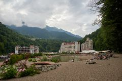 Sochi - Russian Feseration - July 24, 2017 - The beach on the artificial pond of the resort Rosa Khutor royalty free stock photography