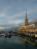 Sochi Sea port at sunset. People on the waterfront, boat mooring, beautiful evening sky Stock Photo