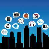Social city. Abstract social city silhouette with different social media icons Royalty Free Stock Image