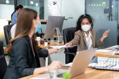 Free Social Distance Office With Business Team Wear Face Mask As New Normal Life Stock Images - 196712704