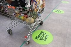 Free Social Distancing Marks On Supermarket Floor Intended To Stop Or Slow Down The Spread Of A Contagious Coronavirus COVID-19 Stock Photography - 177423472