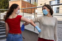 Social distancing, people greeting with elbow. Alternative handshake during epidemic. Covid 19 pandemic. Coronavirus prevention