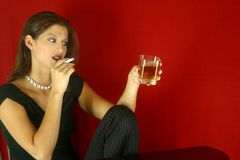 Social Drinking Woman. Woman having a drink and a smoke royalty free stock image