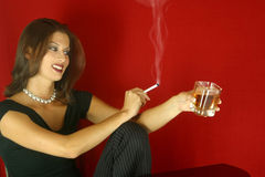 Social Drinking Woman. Woman having a drink and a smoke royalty free stock photography