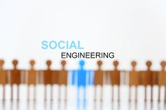 Free Social Engineering Sign Above Line Of Toy Human Figures Stock Image - 144939181
