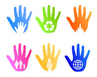 Social environment hand elements. Illustrated hand prints with social and environment elements as logo templates or icons Royalty Free Stock Photos