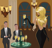 Social event. Lady with a glass of champagne is flirting with men at the party Royalty Free Stock Images