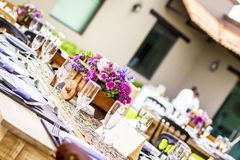 Social event table with floral centerpiece Royalty Free Stock Photo