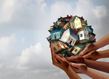 Social Housing Concept. And supportive home ownership symbol as a group of diverse hands holding many family homes as a metaphor for supporting neighborhood vector illustration