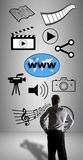 Social information sharing concept watched by a businessman Stock Image