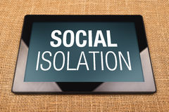 Social Isolation. Digital Tablet Computer with Social Isolation displayed on the screen Stock Images