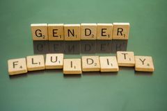 Social Issues Scrabble Letter Tiles Gender Fluidity. Letter tiles spelling out Gender Fluidity, to discuss controversial policies and interpretations of the Stock Photo