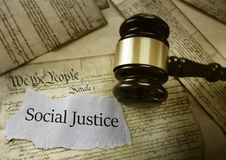 Social Justice news. Headline with gavel on a copy of the US Constitution Royalty Free Stock Photos