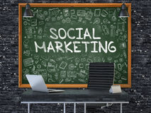 Social Marketing on Chalkboard with Doodle Icons. Stock Photo