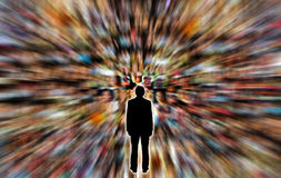 Social media. Man standing with a blur motion background with people's faces Royalty Free Stock Photo
