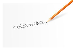 Social media. Writing the words social media with a pencil Stock Photo