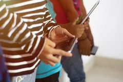 Social media addiction, Closeup of kids hand using the smartphone. royalty free stock photos