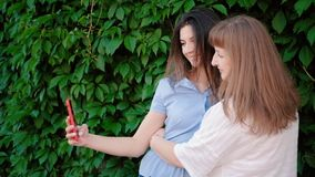 Social media addiction life moments capturing. Social media addiction. Life moments capturing sharing. Mother daughter taking selfie on phone stock video footage