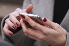 Social Media addiction. young beautiful woman holding a smartpho Royalty Free Stock Image
