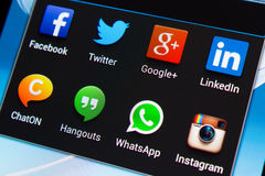 Social media applications on mobile phone. Samsung Galaxy Note 2 screen with social media applications of Facebook, Twitter, Google+, Linkedin, ChatON, Hangouts royalty free stock images