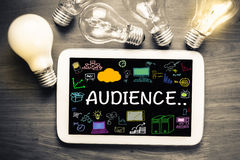 Social Media Audience. Audience concept on tablet with glowing light bulbs Stock Photo