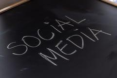 Social Media on the Blackboard. Handwritten chalk text SOCIAL MEDIA on the blackboard royalty free stock photography