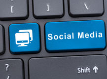 Social media on blue button on keyboard Royalty Free Stock Image