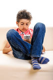 Social media boy with cell phone Royalty Free Stock Photos