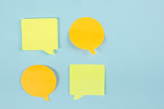 Social Media Chat Concept. Yellow blank empty chat bubble for text on blue background. Symbol of live chat. Office table Stock Photo