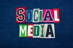 SOCIAL MEDIA collage of word text, multi colored fabric on blue denim, personal online presence concept. Horizontal aspect royalty free stock photography