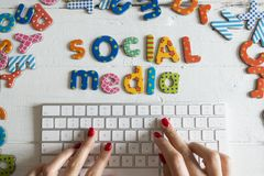 Social media communication concept with colourful text on white computer keyboard royalty free stock photos