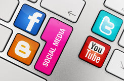Social Media Concept. Facebook, Blogger, Twitter & Youtube logos pasted to keyboard keys. This social media sites the most visited in the world Stock Images