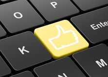 Social media concept: Thumb Up on computer keyboard background. Social media concept: computer keyboard with Thumb Up icon on enter button background, 3D Stock Photography
