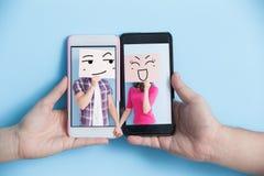 Social media concept. Hand take smart phone with social media concept in screen on blue background Stock Photo