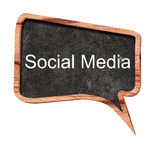 Social media concept on speech bubbles from wood on white background Stock Photos