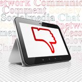 Social media concept: Tablet Computer with Thumb Down on display. Social media concept: Tablet Computer with  red Thumb Down icon on display,  Tag Cloud Stock Image