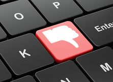 Social media concept: Thumb Down on computer keyboard background Royalty Free Stock Images